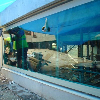 Large glass pool panel installation