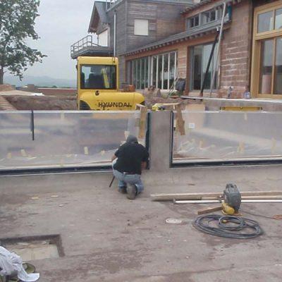Infinity edge pool glazing installation