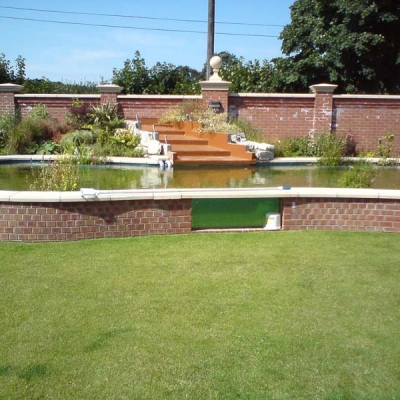 Glazing panel in large landscaped pond