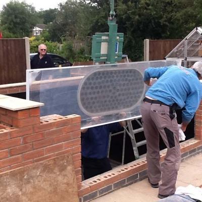 Custom built Koy carp pond glazing installation